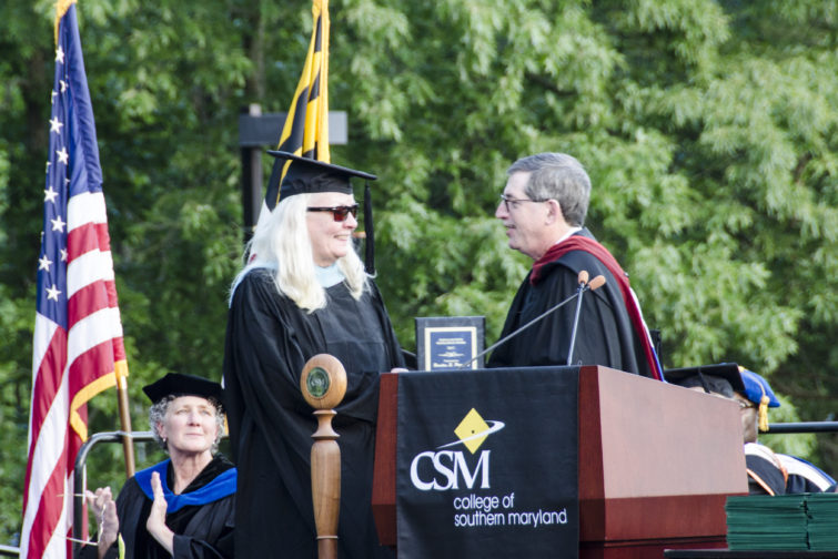 CSM Professor Sandy Poinsett, winner of the Faculty Excellence Award, is congratulated by Faculty Senate President Mike Green