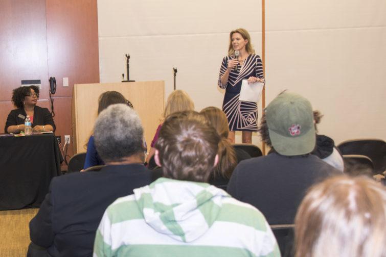 Denise Gilmer-Knudson facilitates a panel discussion