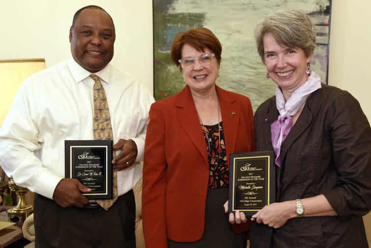 Dr. Maureen Murphy, center, recognized Associate Professor Dr. Cicero Fain III, left, and Professor Michelle Simpson
