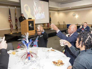 Participants share a toast to POWs