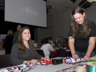 College of Southern Maryland nursing students, left to right, Kattie Woomer of Lusby and Melissa Moy of Waldorf help wrap Christmas gifts at the college's Leonardtown Campus on Dec. 7.
