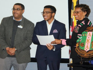 College of Southern Maryland Men of Excellence Program Coordinator Tim Fenner, left, celebrates with CSM Student Micah Kay, center, as Kay is announced the collegiate winner of the AKA MLK Day of Service Essay by Nu Zeta Omega Chapter President Denise Barnes, right. (Submitted photo)
